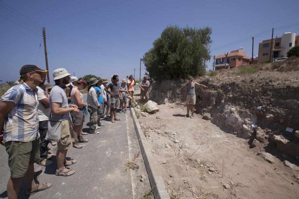 Excavators discuss the road cut profile at Palloures.