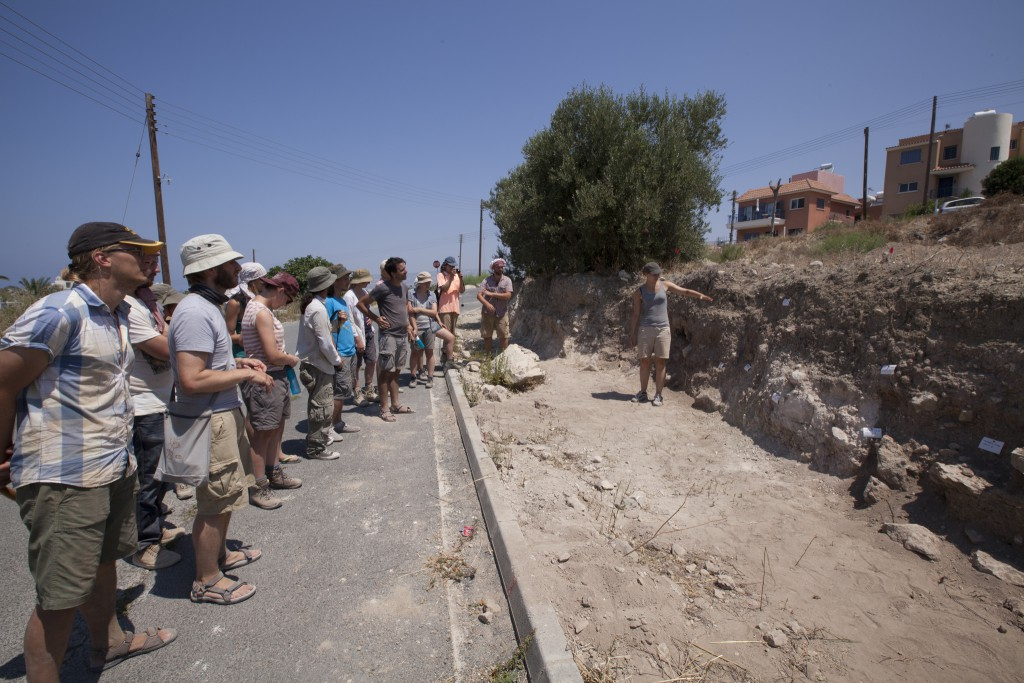 Excavators discuss the road cut profile at Palloures.